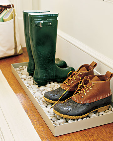 Make an average boot tray beautiful by adding some white rocks to the bottom.