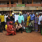 tn_Hon. Baba Jamal poses in a group photograph with the ISD staff in the Upper West Region.JPG