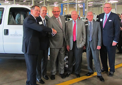 BAF president John Bacon shakes with Metropolitan Utilities District president and NGVAmerica chairman Doug Clark. Between them is Clean Energy Fuels COO Mitchell Pratt, and to Doug Clark's left are Clean Energy founder T. Boone Pickens, BAF founder and VP Bill Calvert, and Clean Energy president and CEO Andrew Littlefair.