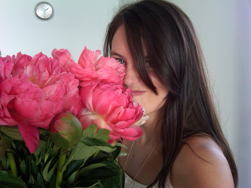 My expression doesn't quite convey the sweet smell of the peonies.