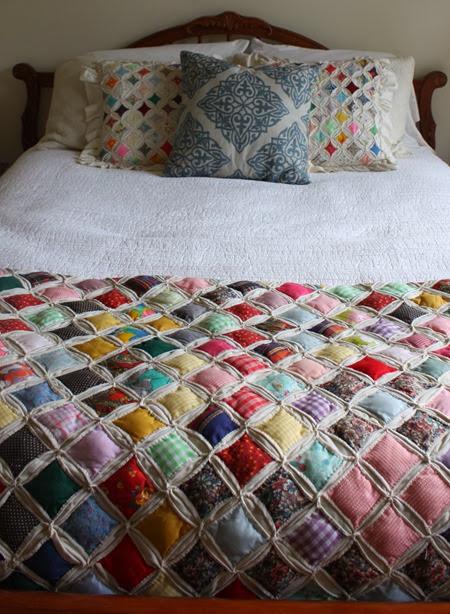 vintage quilt in guest room