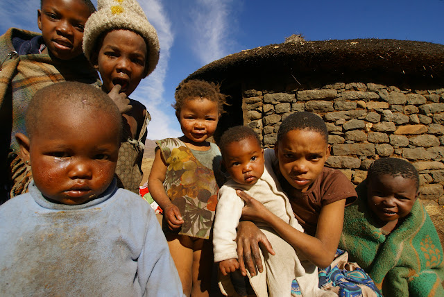 Curious Besotho children crowd around me.
