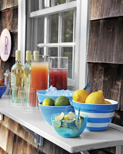If you do not have enough space on your deck for a standing bar, a dropdown surface is a great choice as well. This shot was taken at Rebecca Robertson's (our decorating editor) summer home.   (marthastewart.com)