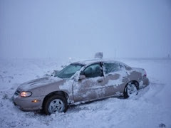 The weekend of our first big snow storm of the year. Gust of wind & I spun off the interstate (on the way to cover for the clinic in Rock Springs). I had to get towed back on to the freeway, but car was working fine - no big damage!