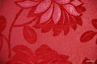 Tkanina obiciowa z efektem metalicznym w kwiaty. Czerwona.
