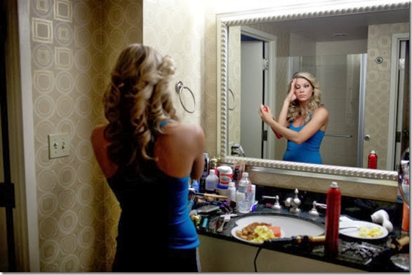 A contestant gets ready in her room before one of the competitions.