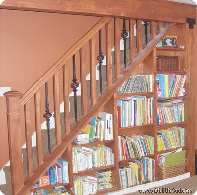 obseussed bookshelves under stairs
