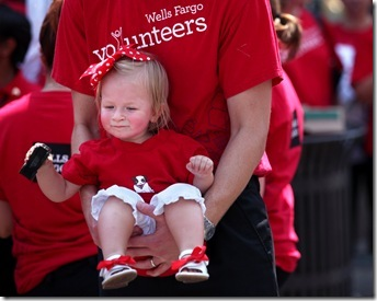 REBECCA BARNETT  |  The Roanoke Times   August 25, 2011 Donny Smith of Roanoke holds his daughter, 17-month-old Madeline, before the start of Wells Fargo's parade in downtown Roanoke Thursday. Donny is an analyst for Wells Fargo and said he brought Madeline so she could see the stagecoach.