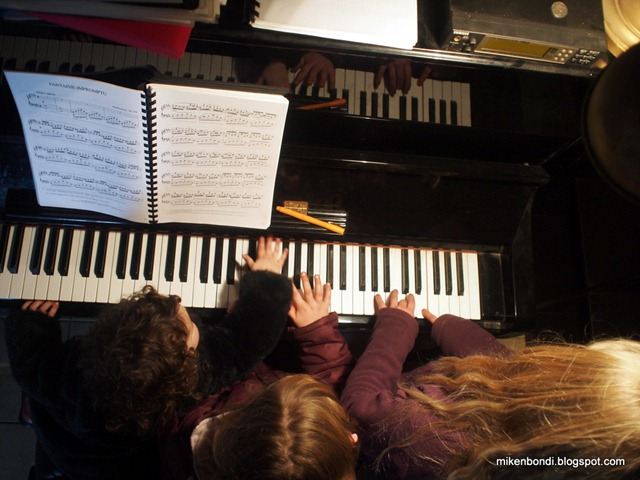 Six hands on the piano: Zelie, Minty and Lucy