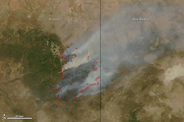 The Moderate Resolution Imaging Spectroradiometer (MODIS) on the Terra satellite acquired this image of the Wallow Fire on June 9, 2011 at 10:55 a.m. local time. Active fire areas are outlined in red. Smoke rises from the most intensely burning areas, but overall, the fire is producing less smoke than in previous days. NASA image courtesy Jeff Schmaltz, MODIS Rapid Response Team at NASA GSFC
