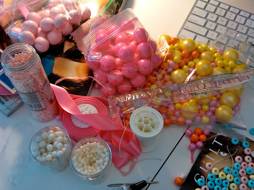 What you're seeing: Fancy Flours pink candy pearls, delicious Madelaine pale-pink malt balls, hot-pink Sweetworks gumballs and pearlized Sixlets candy-coated chocolate-flavored candies, and Midori ribbon in 