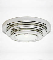 What is so useful about ceiling-hugging fixtures that are round is that you don't have to worry about a straight line matching up with straight walls. Round Stepped Deco Light.