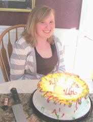 19th birthday party Katie with lighted birthday candles cake