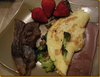 Avocado, broccoli scallion  & mushroom omelet, grass fed beef bacon and strawberries