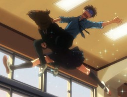 A female student leaps dramatically in the school hallway while wearing a bull's mask and carrying a male student horseback-style