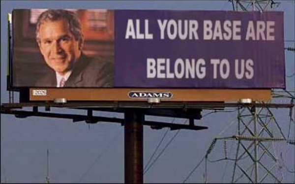 "Billboard showing George Bush and reading ""All Your Base Are Belong To Us"""