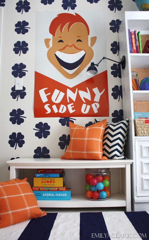 Kids' room reading spot with bench & vintage poster