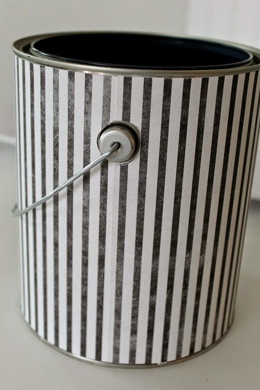 covering a paint can with scrapbook paper