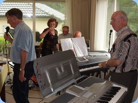 Our host for the day, Peter Brophy playing along with Len Hancy on vocals and Ron Stanwell and John Perkin jam along. Bev Barnes is seen getting into the action!