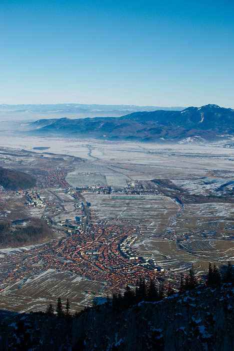 Looking over Zarnesti on a crisp mountain morning, Piatra Craiului, Romania.