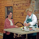 Sandy shares Cancer Project recipes, Carol looks on. January 2008