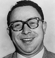 circa 1955:  Headshot portrait of American journalist Art Buchwald smiling in a plaid sports coat.  (Photo by Hulton Archive/Getty Images)