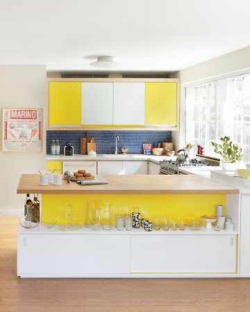 This kitchen is so bright and vibrant and I love the open shelf used as a display space.  (Annie Schlecter/Marthastewart.com)