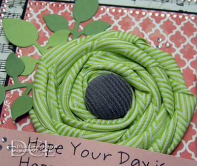 HappyDayTin_WithBigGreenRibbonFlower_FlowerCloseup