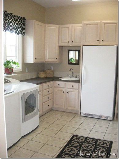 White freezer, brown counters, beige tile floor