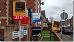 Letting agent boards in Newtown