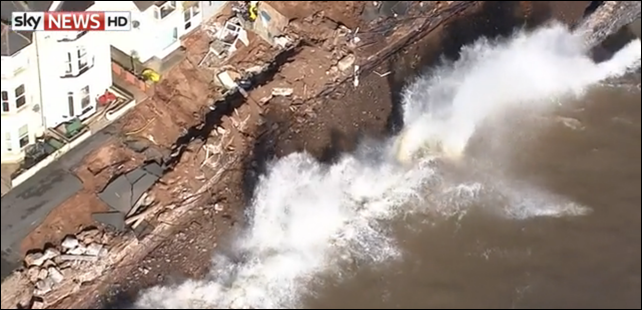 Aerial view of waves eroding through the Dawlish rail line in Devon. Southern Britain was hit by hurricane-force winds and heavy rain, combined with high tides, on 8 February 2014. Photo: Sky News