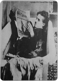 Chaplin reading the Police Gazette