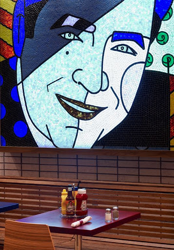 Burgers and More by Emeril in Pennsylvania. A pop art mosaic of Emeril kicks up the impact of the dining area.