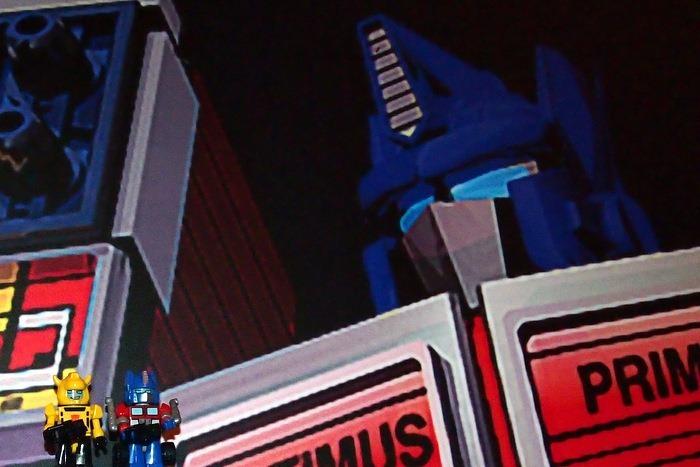 Tattooed Primt looking at Kreon Optimus Prime and Bumblebee