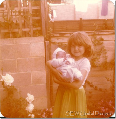 Vikki age 4 holding babe