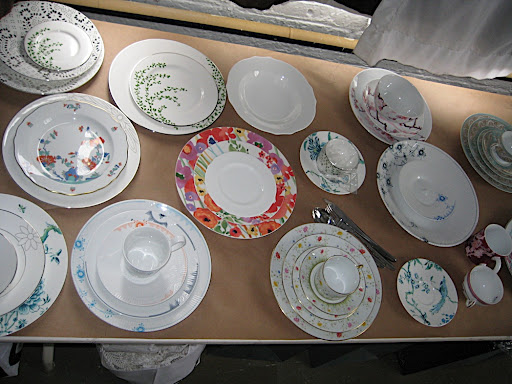 Here is a portion of a table of floral patterned plates.