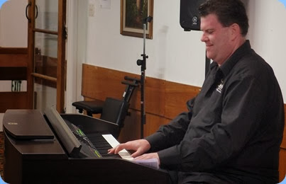 Our guest artist, Chris Larking, played a few straight piaon pieces on our Yamaha Clavinova CVP-509. Photo courtesy of Dennis Lyons