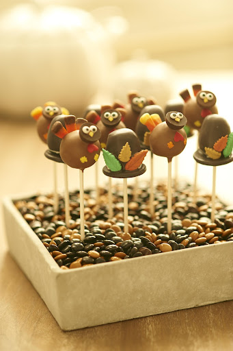 Thanksgiving themed cake pops from NYCake Pops, www.nycakepops.com. presented in a vessel filled with candy make will be a huge hit with your kids
