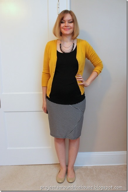 mustard cardigan, black tank, black and white striped skirt