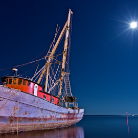 Lost Dreams On The Gulf Coast by Todd Lambert - Transportation Boats ( moon, katrina, beached, shrimp, louisiana, alabama, ghost, boat, hurricane, island, mississippi, hurricane katrina, tranquil, gulf coast, ghost ship, blue. water. calm, shrimp boat, long exposure, abandoned )
