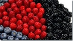 stock-footage-berry-good-arrangement-of-raspberries-blueberries-and-blackberries-rotates-on-plate-against-white