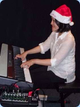 Kuniko Nakatani giving a 30 minute recital with lots of great music including some Christmas songs. Kuniko is playing the Club's Korg SP-250 digital piano.