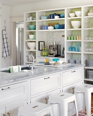 The bright white of this kitchen pairs beautifully with the ikat patterned wallpaper from China Seas. (Annie Schlecter/Marthastewart.com)