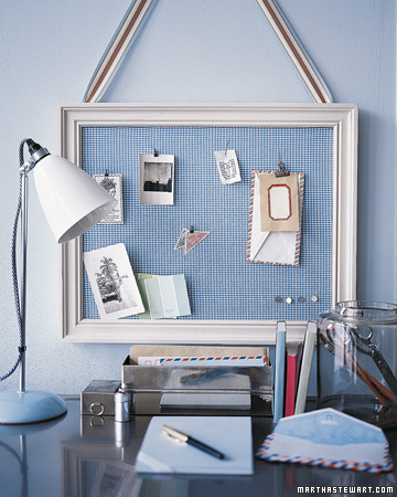 A hardworking bulletin board is, quite literally, pretty as a picture when covered with cheerful fabric, then placed in a frame and hung from a wide ribbon.