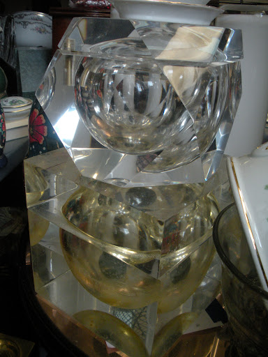 I love the angular shape of these lucite ice buckets.