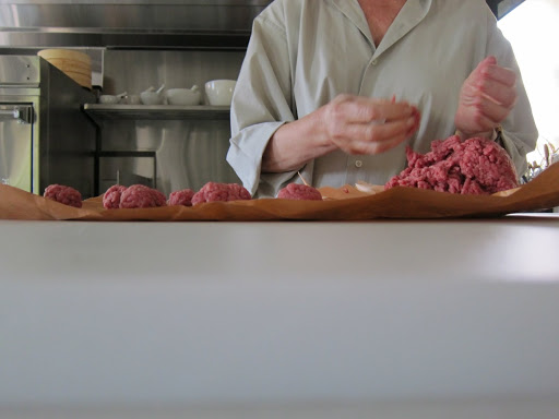 She makes about 72 meat balls.  She gives each of us dogs 3 or 4 meatballs per day, so 3 pounds is good for about a week.