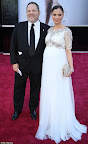 Designer Georgina Chapman of Marchesa, in Marchesa, and her husband, producer Harvey Weinstein.