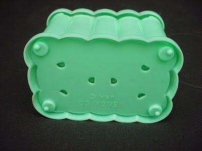 aqua blue plastic cotton ball holder by Menda bottom and imprint