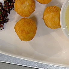 Cheese Filled Risotto Balls With Olives And Cheese Fondue