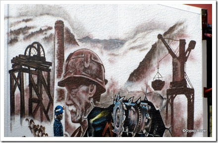 Mural of Greymouths history of coal mining.